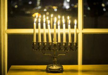 Hannukah menorah lights in a window