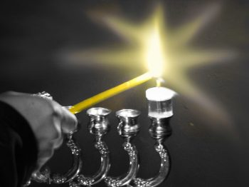 Illustration: lighting a hannukah candle